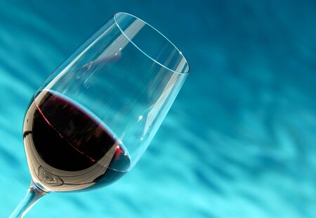 Glass of Wine by the Pool photo