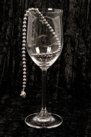 Black pearls in wine glass