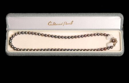 Black pearls in an open jewelry box