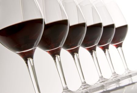Row of Wine Glasses Filled with Red Wine