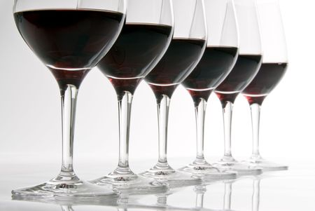 A Row of Wine Glasses Filled with Red Wine Stok Fotoğraf