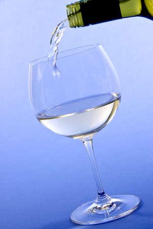 Pouring White Wine Фото со стока