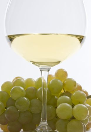 Bunch of White Grape and a Glass of White Wine
