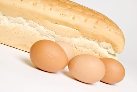 Loaf of White Bread and Raw Eggs Stock Photo - 2845893