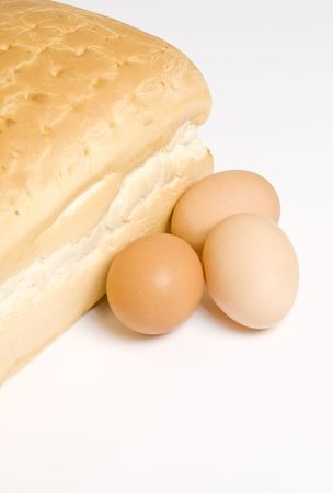 Loaf of White Bread and Raw Eggs