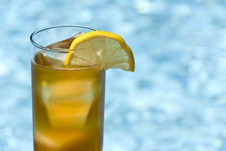 lemon wedge: Tall Glass of Cool Ice Tea with a Lemon Wedge