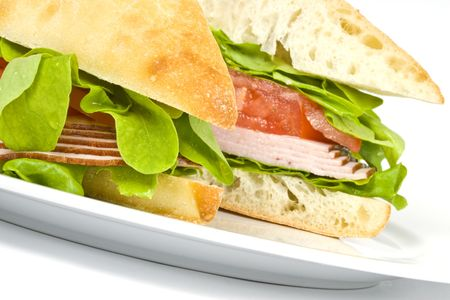 Foccacia Sandwich with Ham, Tomatoes and Leafy Green Vegetables Imagens