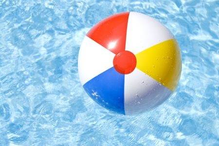 pool ball: Colorful Beach Ball Floating in a Swimming Pool