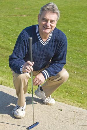 Golfer with a Putter Reklamní fotografie