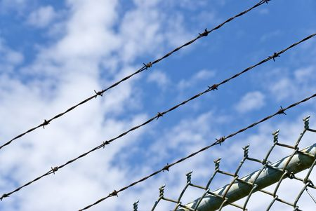 Barbed Wire Against Blue Sky Imagens