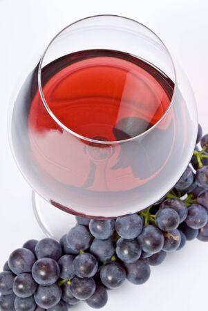 赤ワインと紫のブドウのガラス 写真素材