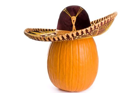 Big Pumpkin Wearing a Sombrero Isolated on White photo