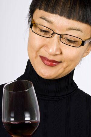 taster: Asian Woman Wine Taster
