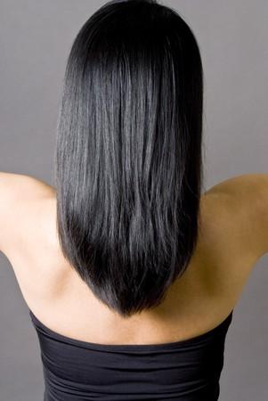 Rückansicht einer Frau mit langen, geraden schwarzen Haaren Standard-Bild - 4408804