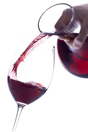 Pouring Red Wine from a Decanter Stock Photo - 4595040