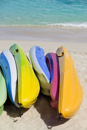 Bunch of Colorful Kayaks on a Tropical Beach