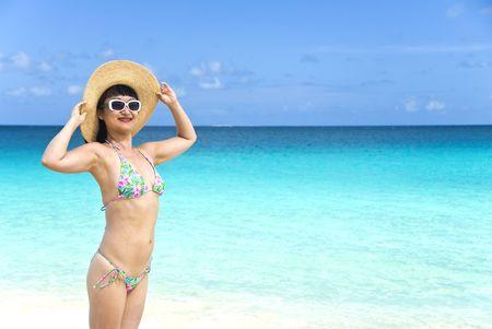 Asian women in string bikinis