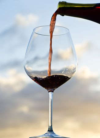 back lit: Pouring Red Wine Back Lit by Sunset Stock Photo