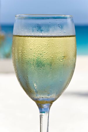 white wine: Chilled White Wine on the Beach Stock Photo