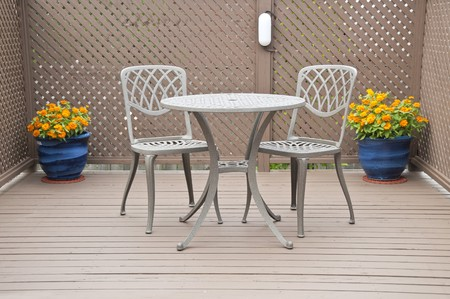 Bistro Table and Chairs on a Deck photo