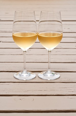Two Glasses of White Wine on the Deck photo