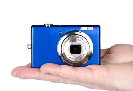 Man Holding a Small Digital Camera photo