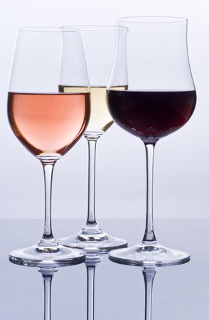 expensive: Filled Wine Glasses and Their Reflections Stock Photo