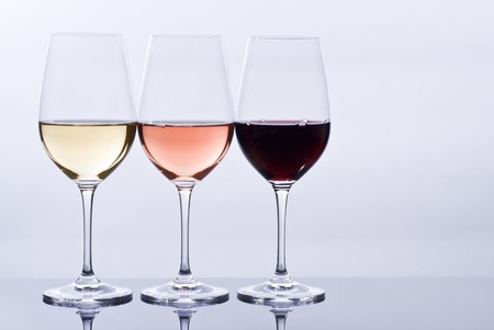 Filled Wine Glasses and Their Reflections Stock Photo