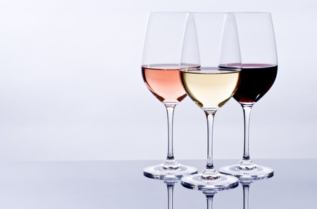 redwine: Filled Wine Glasses and Their Reflections Stock Photo