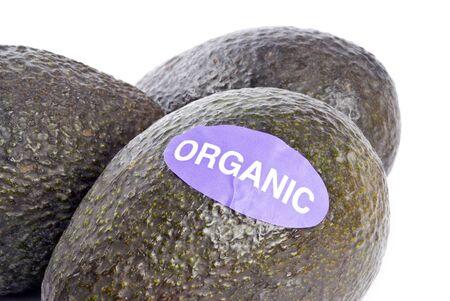 bumpy: Organic Avocados Isolated on White