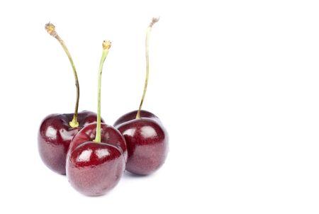 bing: Three Bing Cherries Isolated on White