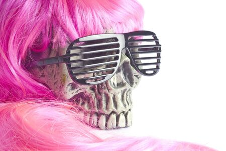 dressing up costume: Halloween Skull with Pink Wig and Black Sunglasses Stock Photo