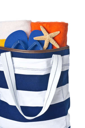 Beach Bag with Blue Towels, Blue Flip Flop and Starfish Isolated on White photo