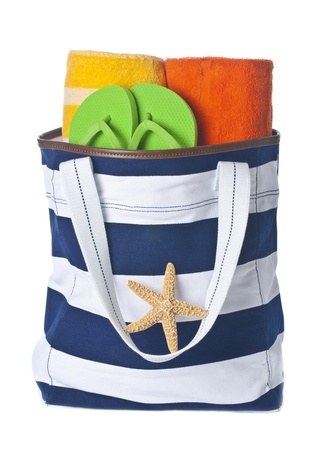 Beach Bag with Towels, Green Flip flop and Starfish Isolated on White photo