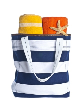 white canvas: Beach Bag with Towels and Starfish Isolated on White