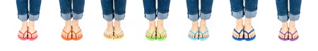 flops: Woman Wearing Flip Flops in Rainbow of Colors Isolated on White