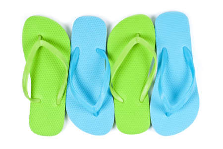 Lime Green and Blue Flip Flops Isolated on White