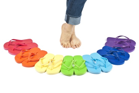 Womans Feel and Flip Flops in Rainbow of Colors Isolated on White Stock Photo