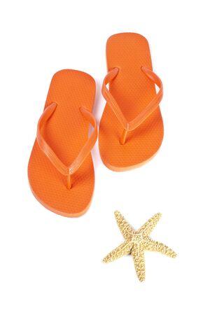 Orange Flip Flop and Starfish Isolated on White photo