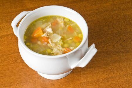 chicken soup: Homemade Chicken Soup with Vegetables in a Bowl Stock Photo
