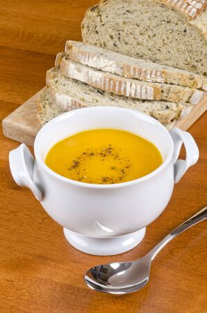 Carrot Soup Served with Pre-sliced Herb and Olive Bread photo