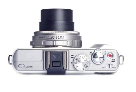 ポイントと撮影デジタル カメラを白で隔離されます。 写真素材