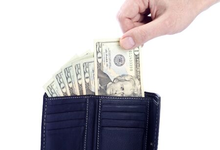 Hand Pulling a  US 20 Dollar Bill from a Black Leather Wallet photo