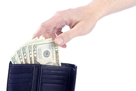 Hand Reaching US 20 Dollar Bills in a Black Leather Wallet photo