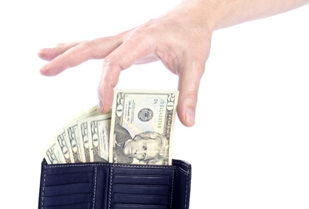 Hand Reaching US 20 Dollar Bill in a Black Leather Wallet photo
