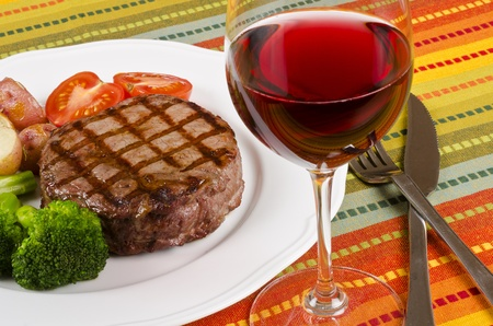 Beef Rib Eye Steak Served with Vegetables and Red Wine