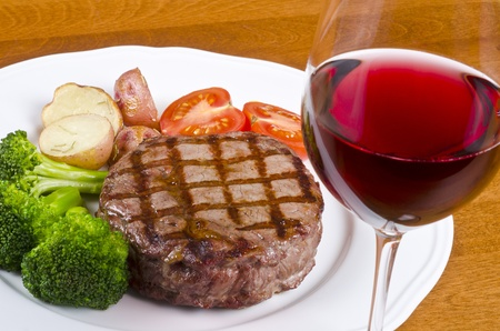 glass of red wine: Beef Rib Eye Steak Served with Vegetables and Red Wine