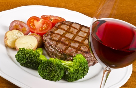 Beef Rib Eye Steak Served with Vegetables and Red Wine Stock Photo - 13427591