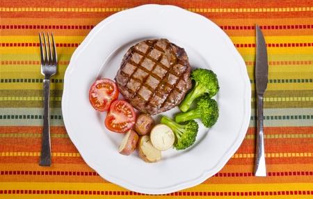 牛リブ アイ ステーキ野菜添え 写真素材