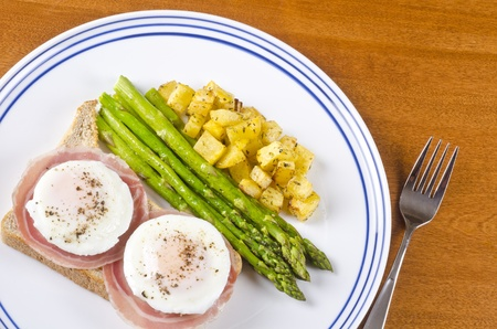 Poached Eggs on Toast Served with Pancetta and Roasted Vegetables photo